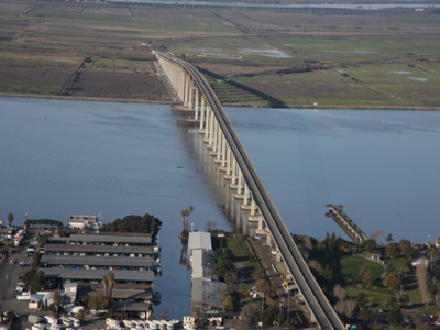 Photo of the Antioch Bridge by Hall, Bill (Caltrans District 4 staff photographer) [Public domain], via Wikimedia Commons