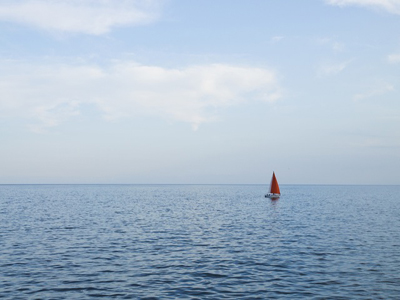 Photo of a sail boat in the ocean