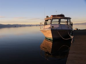 Photo of a boat at a dock in Lake Tahoe by Mark Hinte